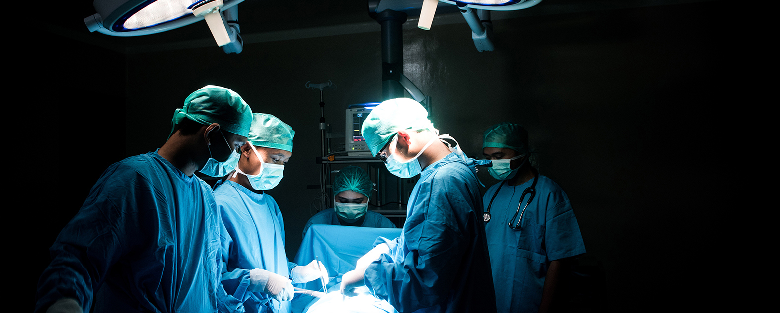 Medical Team Performing Surgical Operation in Modern Operating R